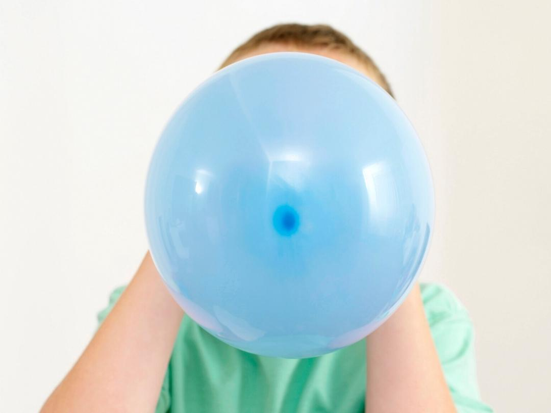 Blowing up a blue balloon